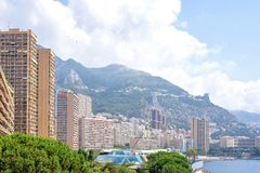 Beautiful daylight view to city buildings and sky. Beautiful daylight view to Monaco city big buildings and sea in France. Big green mountains and bright blue Royalty Free Stock Photos