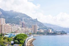 Beautiful daylight view to city buildings and sky. Beautiful daylight view to Monaco city big buildings and sea in France. Big green mountains and bright blue Royalty Free Stock Images