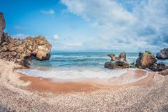Beautiful seascape. Wild rocky sandy seashell beach. A small cozy bay stock images