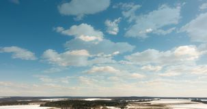 Beautiful daytime timelapse of clouds over the winter landscape.  stock video