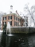 De Kinkelenburg Castle in Bemmel in Winter. The beautiful de Kinkelenburg caste in Bemmel covered with snow in winter. Visible are ducks swimming in the pond and stock image
