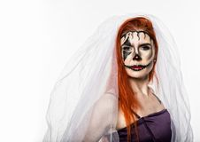 Beautiful dead bride with terrible mask painted on her face. Halloween and creative make-up. Beautiful dead bride with terrible mask painted on her face stock images