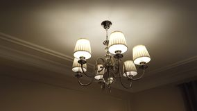 Beautiful and dear modern chandelier in living room. stock photo