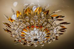 Beautiful and dear modern chandelier in living room. нome ceiling chandelier stock images
