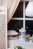 Beautiful decor in beige tones near the window Royalty Free Stock Photo