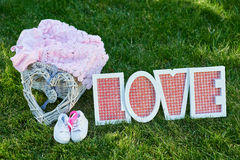 Beautiful decor for a newborn on talbe, wooden letters love Royalty Free Stock Photos
