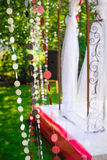 Beautiful decor for the wedding arch in the summer garden Stock Photos