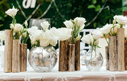 Beautiful decor at the wedding. The flowers on the background of the boards. Close-Up Royalty Free Stock Photography