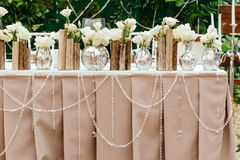 Beautiful decor at the wedding. The flowers on the background of the boards. Stock Images