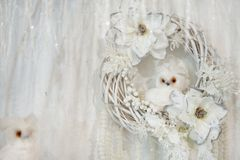 Beautiful decor, white wreath with flowers and little white owl.  royalty free stock photography