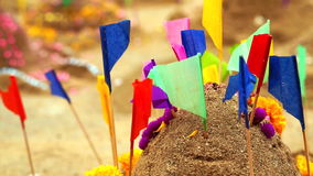 Beautiful decorate sand castle with flags and flower for Thai New Year stock footage