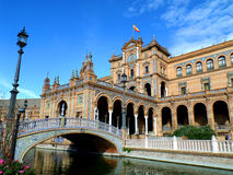 Beautiful Decorated Bridge and Stunning Architecture against the Vivid Blue Sky at Plaza de Espana Royalty Free Stock Photography