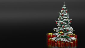 Beautiful decorated christmas tree with red present boxes in a black background Royalty Free Stock Images