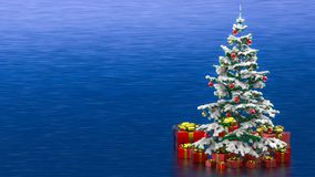 Beautiful decorated christmas tree with red present boxes in a blue background Royalty Free Stock Photography