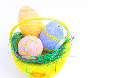 How are celebrating Easter. Beautiful decorated Easter eggs in a yellow basket ,photography Royalty Free Stock Photography