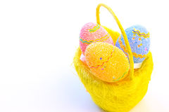 Imaginatively decorating Easter eggs. Beautiful decorated Easter eggs in a yellow basket ,photography Royalty Free Stock Photos