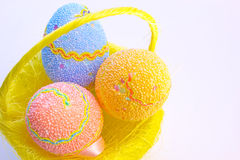 Easter eggs. Beautiful decorated Easter eggs in a yellow basket ,photography Stock Photography