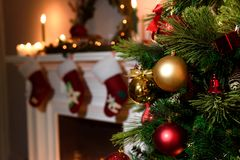 Decorated fireplace and Christmas tree at cottage royalty free stock images