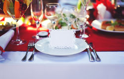 Beautiful decorated place at the table with the guest card on holiday, empty copy space. Background Stock Photography