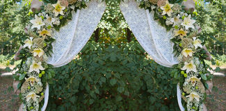 Beautiful decorated wedding arch for the ceremony outdoor Royalty Free Stock Photography