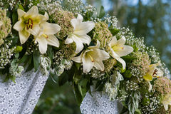 Beautiful decorated wedding arch for the ceremony outdoor Royalty Free Stock Image