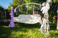 Beautiful decorated for wedding swing at backyard Stock Photography