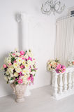 Beautiful decoration of flowers in vases in white studio Royalty Free Stock Photography