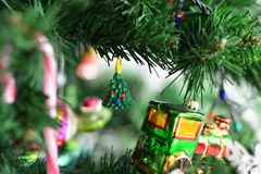 Beautiful decoration made of polymer clay at a green Christmas tree. Photographed close up with spectacular blur background Stock Images