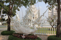 Beautiful Decoration at Wat Rong Khun or White Temple, a contemp. Orary unconventional Buddhist temple in Chiangrai, Thailand, with white Lanna style flags Stock Photo