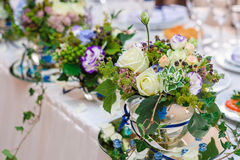 Beautiful decorations of flowers at the wedding table Stock Photos