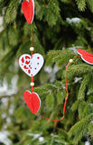 Beautiful decorations of hearts on a green Christmas tree Stock Images