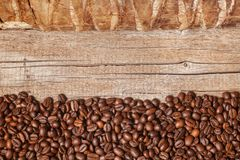 Beautiful decorative background with coffee beans and old dry wood stock photography
