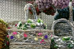Decorative gray basket with colored cones and flowers royalty free stock photo