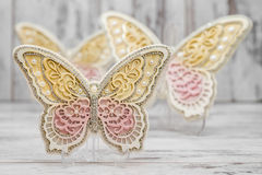 Beautiful Decorative Butterflies. On white wooden background Royalty Free Stock Photos