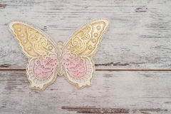 Beautiful Decorative Butterflies. On white wooden background Royalty Free Stock Image