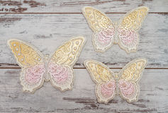 Beautiful Decorative Butterflies. On white wooden background Stock Image