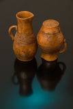 Beautiful decorative clay pots brown on a black background Royalty Free Stock Images