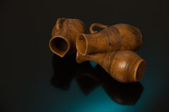 Beautiful decorative clay pots brown on a black background Stock Photo