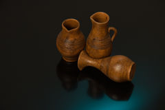 Beautiful decorative clay pots brown on a black background Stock Photography