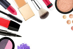 Beautiful decorative cosmetics and makeup brushes, isolated on w Royalty Free Stock Image