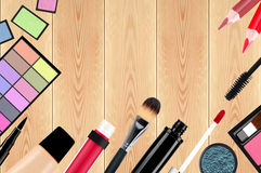 Beautiful decorative cosmetics and makeup brushes on wooden table Royalty Free Stock Image