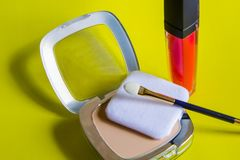 Beautiful decorative cosmetics on a yellow background. royalty free stock photo