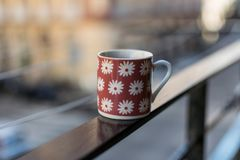 Decorative cup of coffee on the handrail, Naples, Italy. stock photo