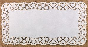 Paper lace dolly. Beautiful decorative lace dolly on bright background Royalty Free Stock Photography