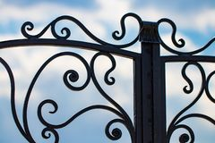Beautiful decorative metal elements forged wrought iron gates.  royalty free stock photos