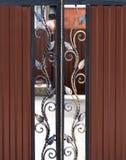 Beautiful decorative metal elements forged wrought iron gates.  stock photo