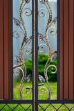 Beautiful decorative metal elements forged wrought iron gates.  stock image