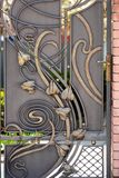 Beautiful decorative metal elements forged wrought iron gates.  stock images