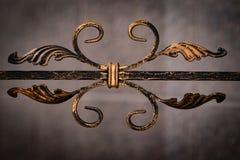 Beautiful decorative metal elements forged wrought iron gates.  royalty free stock photo