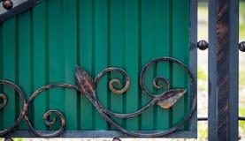 Beautiful decorative metal elements forged wrought iron gates.  stock photos